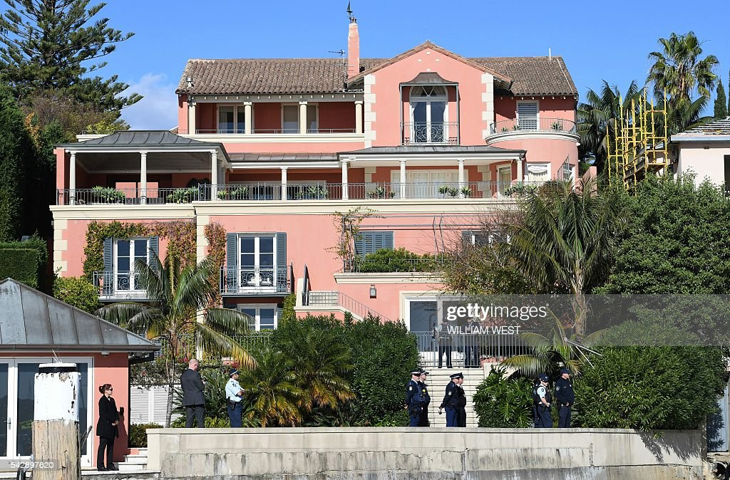 Australia's Prime Minister Malcolm Turnbull's Point Piper mansion, worth a reported 50 million Australian dollars (37.3 million USD), is guarded by police officers after a small group of kayakers landed on a small beach nearby protesting against what they say is government inaction on global warming. WEST