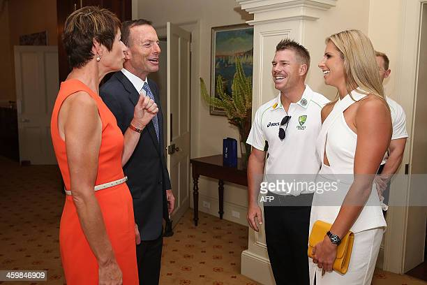 Australia's Prime Minister Tony Abbott along with his wife Margie Abbott receives Australian cricketer David Warner and his partner at a New Year's...