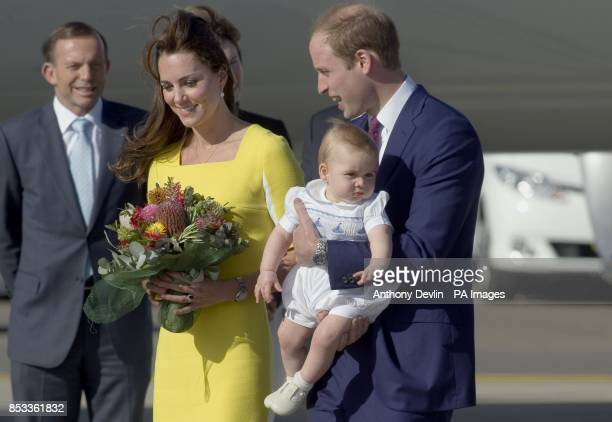 Australia's Prime Minister Tony Abbott lookon as the Duke and Duchess of Cambridge and Prince George arrive at Sydney Kingsford Smith Airport on a...