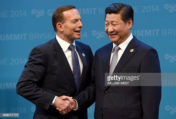 Australia's Prime Minister Tony Abbott offically welcomes China's President Xi Jinping to the G20 Leaders' Summit in Brisbane on November 15 2014...