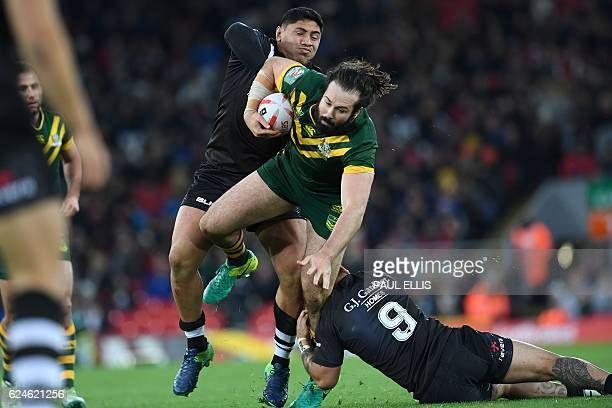 Australia's prop Aaron Woods vies with New Zealand's forward Jason Taumalolo and New Zealand's hooker Issac Luke during the rugby league Four Nations...