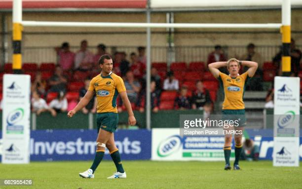 Australia's Quade Cooper and Dane HaylettPetty stand dejected