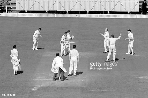 Australia's Ray Lindwall is caught by England's Tony Lock off the bowling of Jim Laker