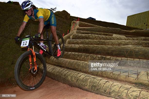 Australia's Rebecca Henderson competes in the cycling mountain bike women's crosscountry race of the Rio 2016 Olympic Games at the Mountain Bike...