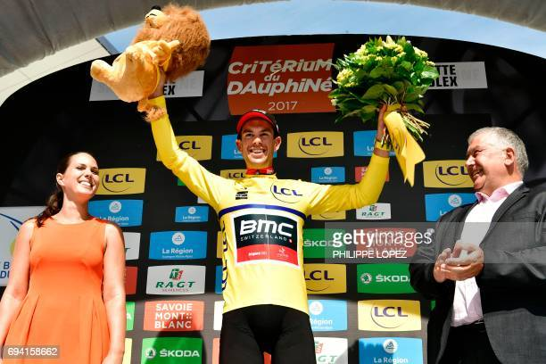Australia's Richie Porte celebrates his overall leader yellow jersey on the podium at the end of the 1475 km sixth stage of the 69th edition of the...