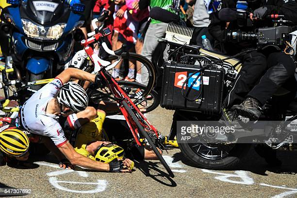 Australia's Richie Porte Netherlands' Bauke Mollema and Britain's Christopher Froome wearing the overall leader's yellow jersey fall on the ground...