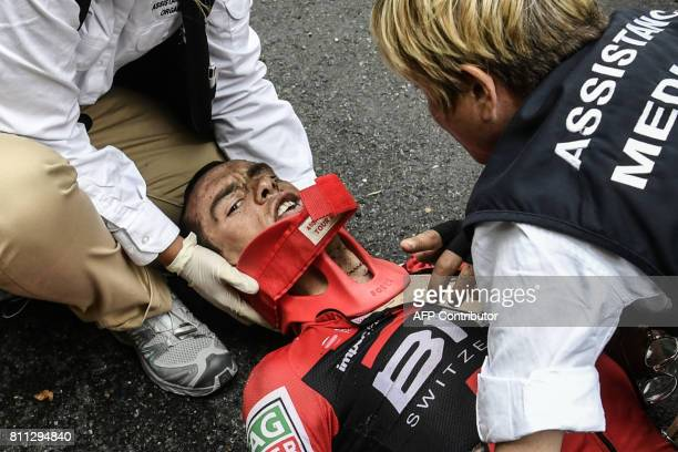 TOPSHOT Australia's Richie Porte receives medical assistance after falling during the 1815 km ninth stage of the 104th edition of the Tour de France...