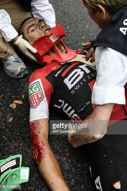 Australia's Richie Porte receives medical assistance after falling during the 1815 km ninth stage of the 104th edition of the Tour de France cycling...