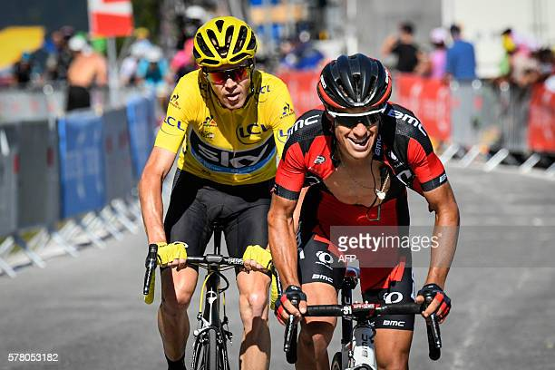 Australia's Richie Porte rides ahead of Great Britain's Christopher Froome wearing the overall leader's yellow jersey during the 1845 km seventeenth...