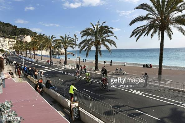 Australia's Richie Porte Spain's Alberto Contador and Belgium's Tim Wellens ride on the 'Promenade des Anglais' during the finish of seven stage of...
