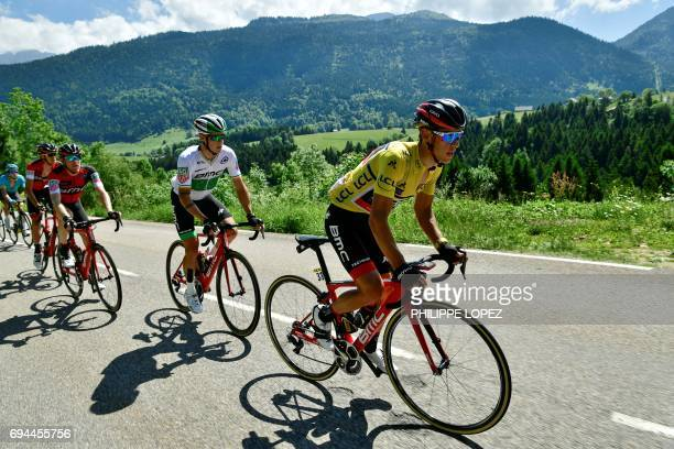 Australia's Richie Porte wearing the overall leader's yellow jersey and his teammate Ireland's Nicolas Roche ride in the pack during the 168 km...
