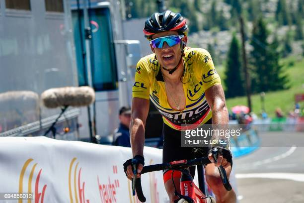 Australia's Richie Porte wearing the overall leader's yellow jersey reacts as he crosses the finish line at the end of the 115 km eighth and last...