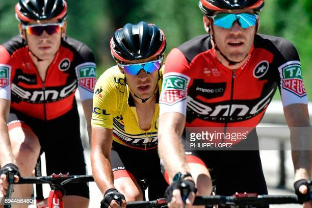 Australia's Richie Porte wearing the overall leader's yellow jersey rides with his teammates of the USA's BMC Racing cycling team during the 168 km...