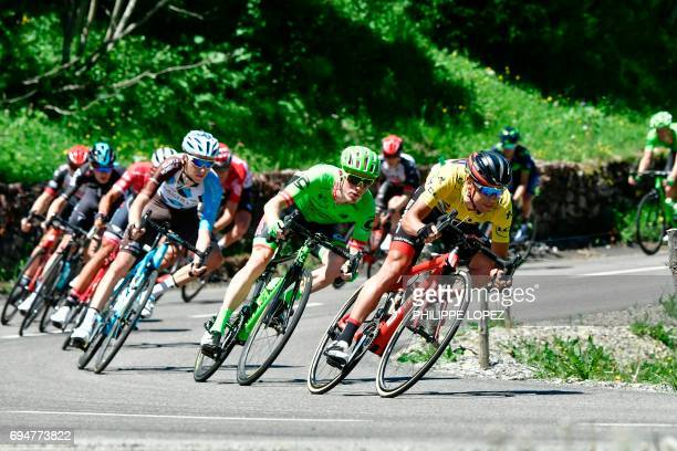 Australia's Richie Porte wearing the overall leader's yellow jersey rides ahead of USA's Andrew Talansky and France's Romain Bardet during the 115 km...
