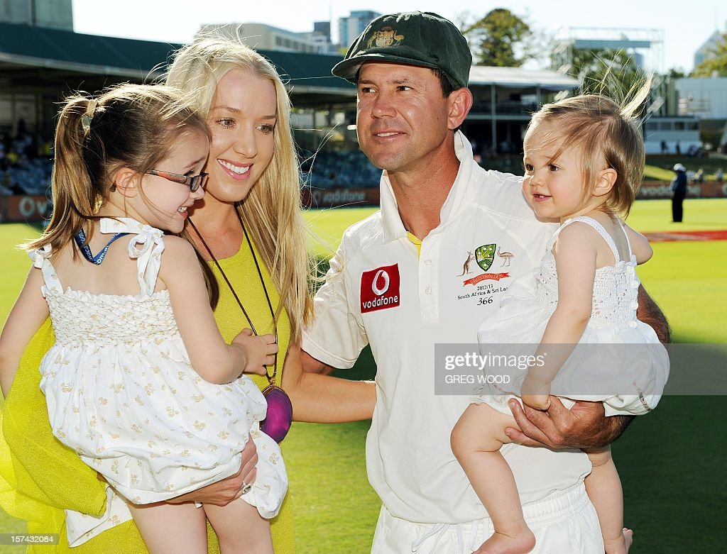 Australia's Ricky Ponting holds daughter Matisse (R), as his wife Riannna holds daughter Emmy (L), following the third Test match between South Africa and Australia at the WACA ground in Perth on December 3, 2012. IMAGE STRICTLY RESTRICTED TO EDITORIAL USE - STRICTLY NO COMMERCIAL USE AFP PHOTO / Greg WOOD