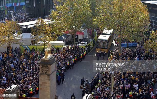 Australia's rugby team bus arrives prior to the final match of the 2015 Rugby World Cup between New Zealand and Australia at Twickenham stadium south...