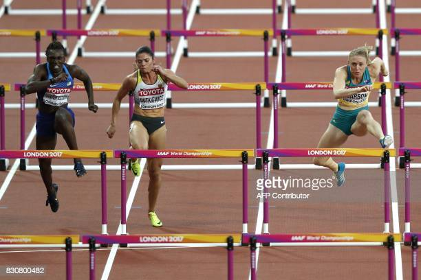 Australia's Sally Pearson jumps a hurdle as she heads to the finish line to win ahead of Germany's Pamela Dutkiewicz in third and US athlete Dawn...