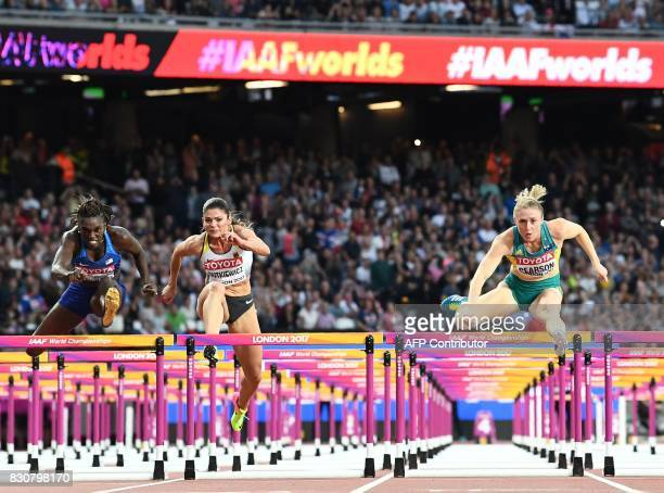 Australia's Sally Pearson jumps a hurdle on her way to winning the final of the women's 100m hurdles athletics event ahead of US athlete Dawn Harper...
