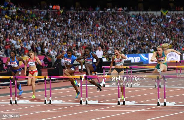 Australia's Sally Pearson jumps a hurdle to win ahead of Germany's Pamela Dutkiewicz in third and US athlete Dawn Harper Nelson in second US athlete...