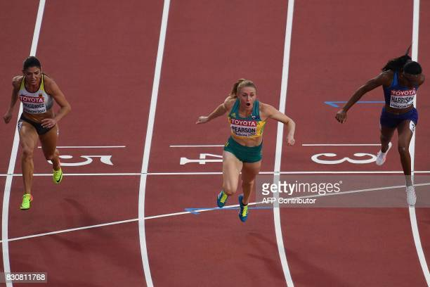 TOPSHOT Australia's Sally Pearson reacts after crossing the finish line to win next to US athlete Kendra Harrison and Germany's Pamela Dutkiewicz in...