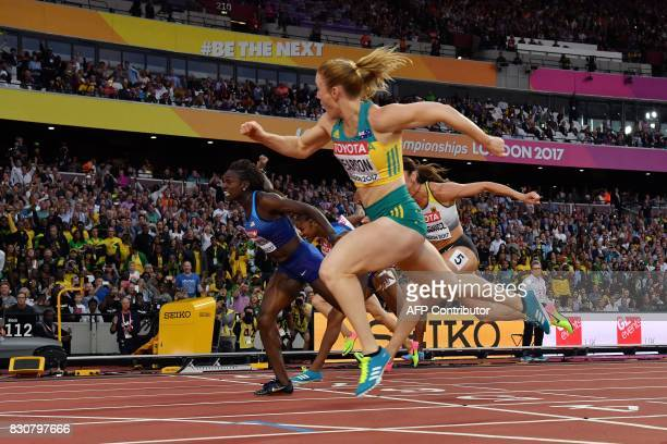 Australia's Sally Pearson wins ahead of Germany's Pamela Dutkiewicz in third and US athlete Dawn Harper Nelson in second in the final of the women's...