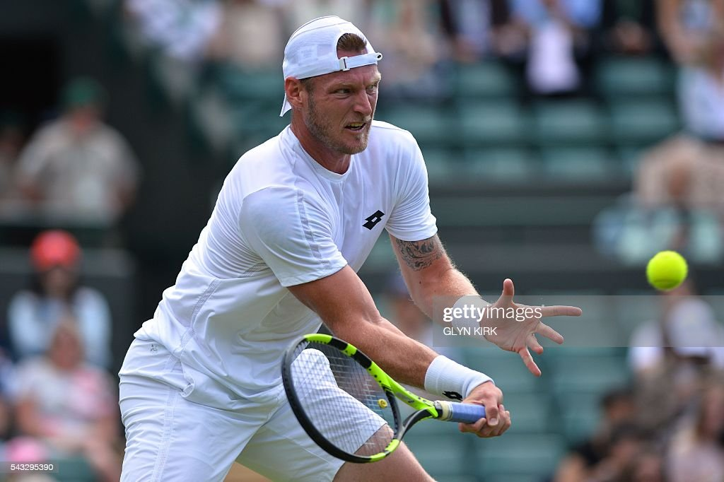 Australia's Sam Groth returns against Japan's Kei Nishikori during their men's singles first round match on the first day of the 2016 Wimbledon Championships at The All England Lawn Tennis Club in Wimbledon, southwest London, on June 27, 2016. / AFP / GLYN