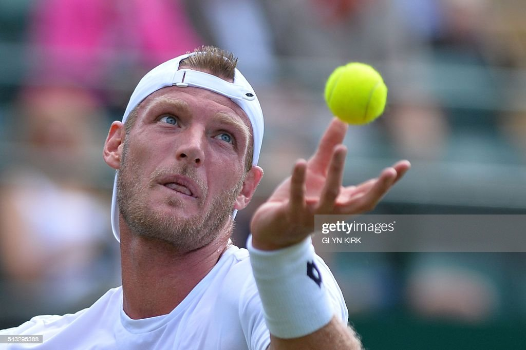 Australia's Sam Groth serves against Japan's Kei Nishikori during their men's singles first round match on the first day of the 2016 Wimbledon Championships at The All England Lawn Tennis Club in Wimbledon, southwest London, on June 27, 2016. / AFP / GLYN