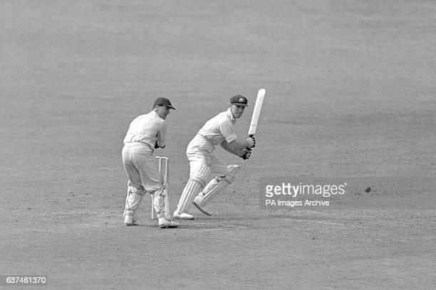 Australia's Sam Loxton cuts the ball watched by England wicketkeeper Godfrey Evans