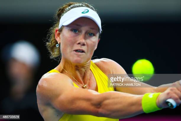Australia's Sam Stosur hits a return against Germany's Angelique Kerber during their match in the Fed Cup semifinal tie tennis match between...