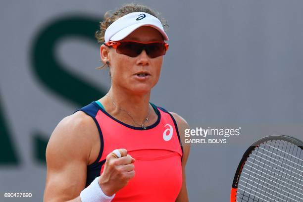 Australia's Samantha Stosur celebrates after winning a point during her tennis match against Belgium's Kirsten Flipkens at the Roland Garros 2017...