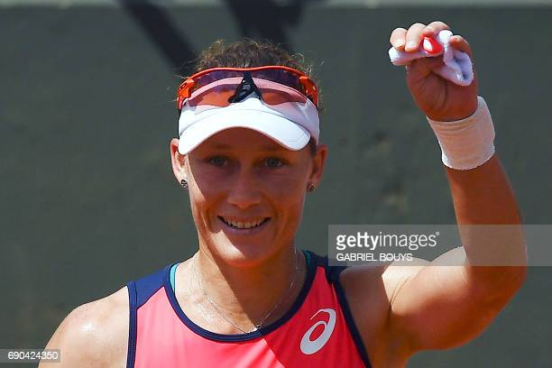 Australia's Samantha Stosur celebrates after winning her tennis match against Belgium's Kirsten Flipkens at the Roland Garros 2017 French Open on May...