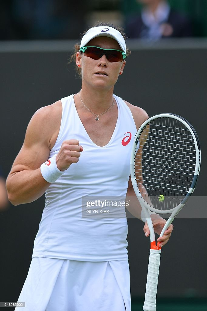 Australia's Samantha Stosur reacts after a point against Poland's Magda Linette during their women's singles first round match on the first day of the 2016 Wimbledon Championships at The All England Lawn Tennis Club in Wimbledon, southwest London, on June 27, 2016. / AFP / GLYN
