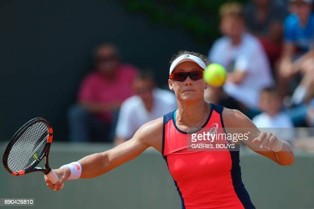 Australia's Samantha Stosur returns the ball to Belgium's Kirsten Flipkens during their tennis match at the Roland Garros 2017 French Open on May 31...