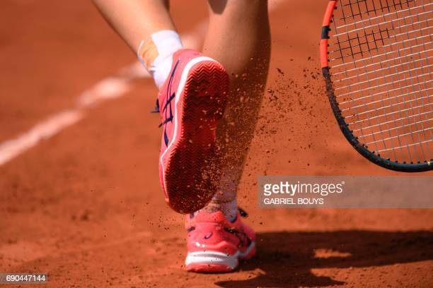 Australia's Samantha Stosur taps dirt off her shoes during her tennis match against Belgium's Kirsten Flipkens at the Roland Garros 2017 French Open...