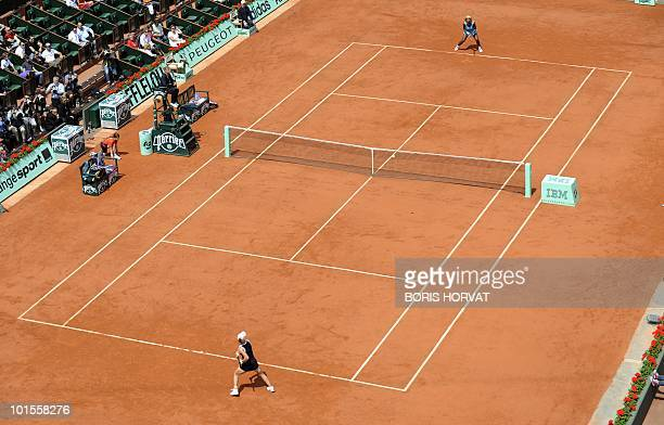 Australia's Samatha Stosur plays a return during her women's quarterfinal against US Serena Williams in the French Open tennis championship at the...