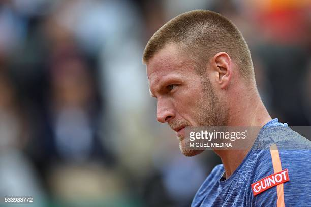 Australia's Samuel Groth reacts during his men's first round match against Spain's Rafael Nadal at the Roland Garros 2016 French Tennis Open in Paris...