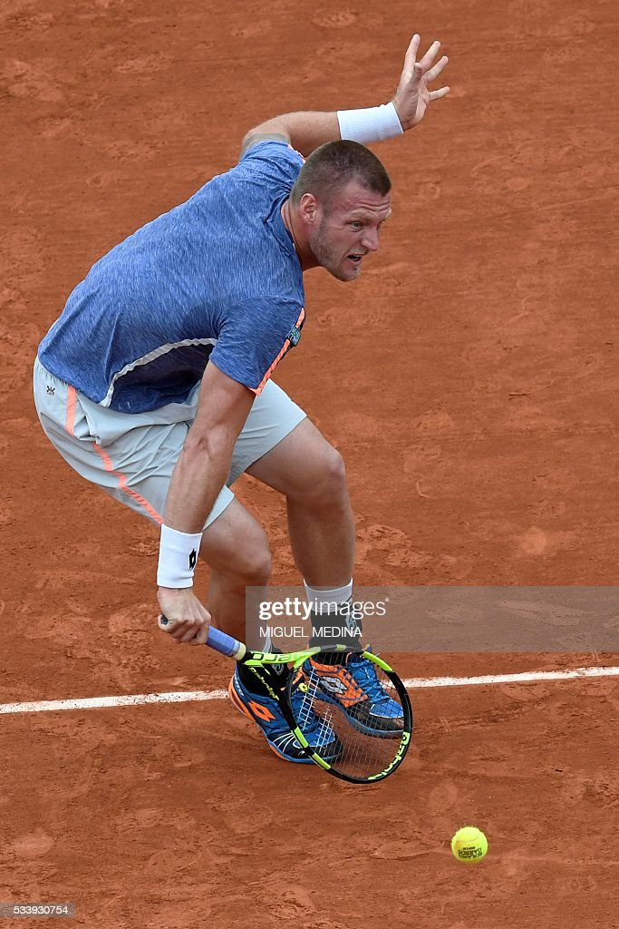 Australia's Samuel Groth returns the ball to Spain's Rafael Nadal during their men's first round match at the Roland Garros 2016 French Tennis Open in Paris on May 24, 2016. / AFP / MIGUEL