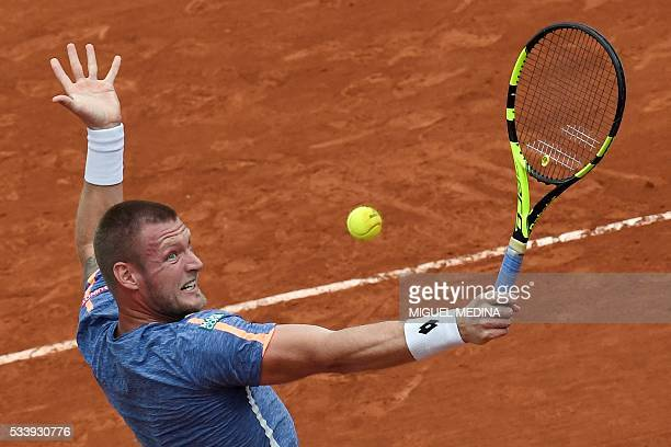 Australia's Samuel Groth returns the ball to Spain's Rafael Nadal during their men's first round match at the Roland Garros 2016 French Tennis Open...