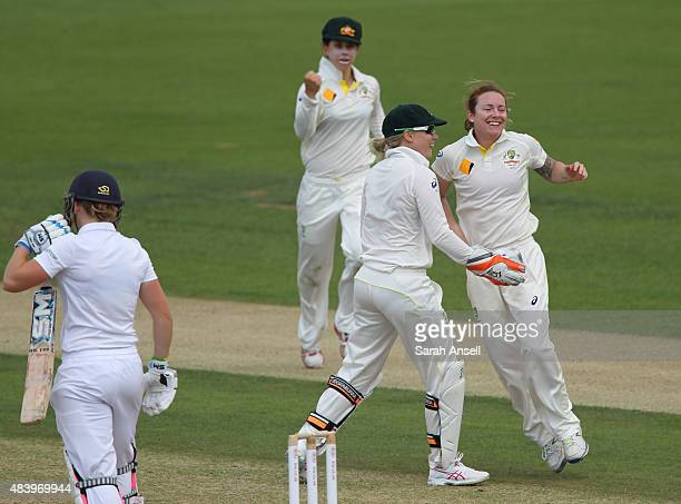 Australia's Sarah Coyte celebrates with teammates after dismissing England's Heather Knight during day four of the Kia Women's Test of the Women's...