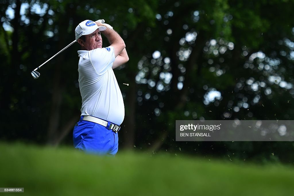 Australia's Scott Hend hits a tee shot on the 2nd hole during the second day of the PGA Championship at Wentworth Golf Club in Surrey, south west of London, on May 27, 2016. / AFP / BEN