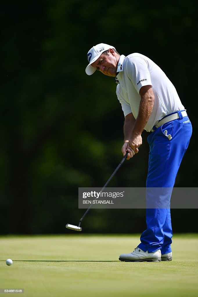 Australia's Scott Hend putts on the 1st hole during the second day of the PGA Championship at Wentworth Golf Club in Surrey, south west of London, on May 27, 2016. / AFP / BEN