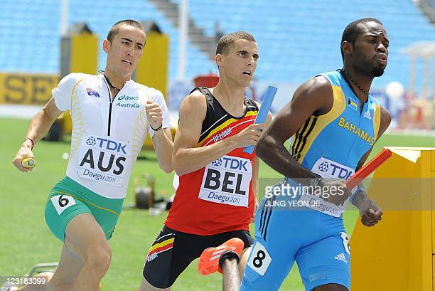 Australia's Sean Wroe Belgium's Kevin Borlee and Bahamas's LaToy Williams compete during the men's 4x400 metres relay heats at the International...