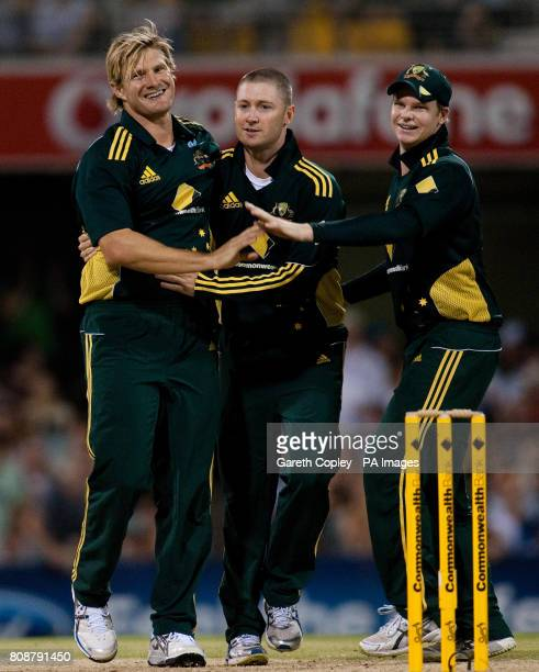 Australia's Shane Watson celebrates with Michael Clarke and Steven Smith after dismissing England's Chris Woakes during the Fifth One Day...