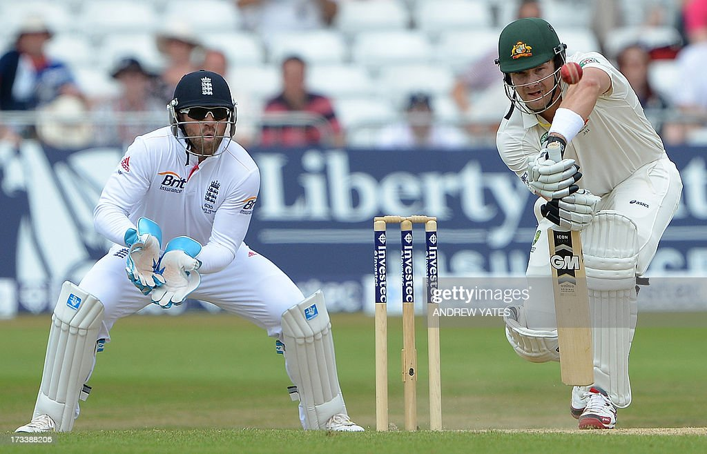Australia's Shane Watson plays a shot as England's Matt Prior reacts behind the stumps during play on the fourth day of the first Ashes cricket test...