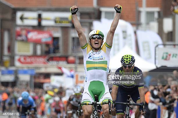 Australia's Simon Gerrans celebrates as he crosses the finish line ahead of Poland's Michal Kwiatkowski and Spain's Alejandro Valverde and wins the...