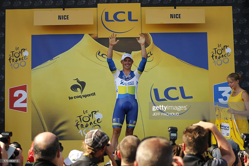 Australia's Simon Gerrans celebrates his overall leader yellow jersey on the podium at the end of the 25 km team time-trial and fourth stage of the 100th edition of the Tour de France cycling race on July 2, 2013 around Nice, southeastern France.
