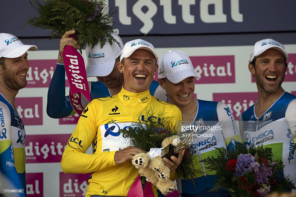 Australia's Simon Gerrans (C) celebrates his Overall leader's yellow jersey with his teammates after they won the 25 km team time-trial and fourth stage of the 100th edition of the Tour de France cycling race on July 2, 2013 around Nice, southeastern France.