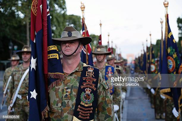 Australia's soldiers attend a rehearsal of the annual Bastille Day military parade on July 12 2016 on the Champs Elysees in Paris SAMSON