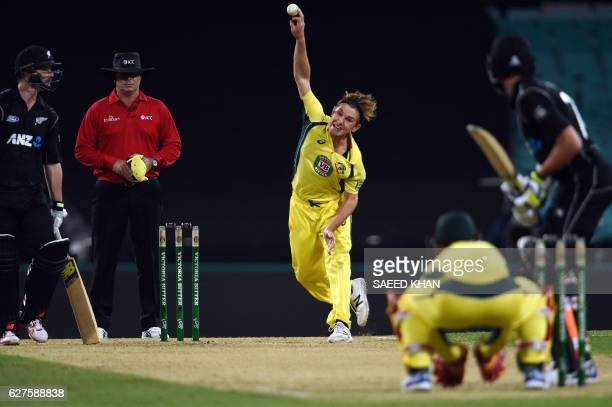 Australia's spinner Adam Zampa bowls to New Zealand's Colin de Grandhomme during the first game of the One Day International Cricket series between...