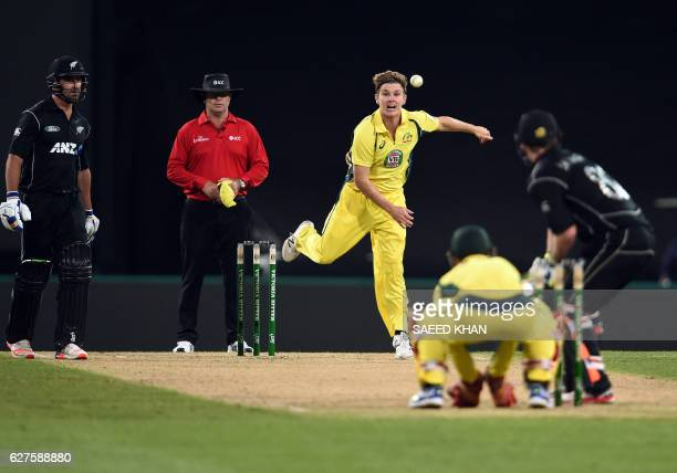 Australia's spinner Adam Zampa bowls to New Zealand's Colin Munro during the first game of the One Day International Cricket series between Australia...